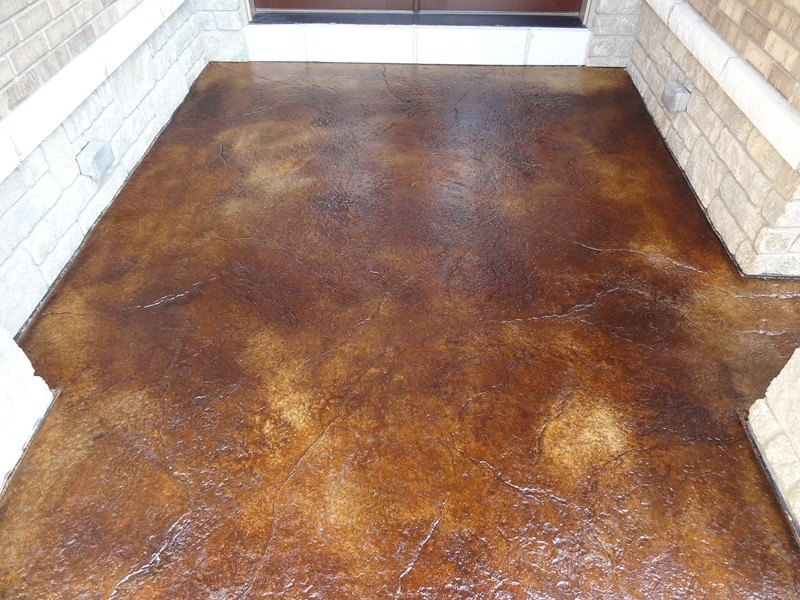 Stamped concrete driveways patios foundations for Black stains on concrete