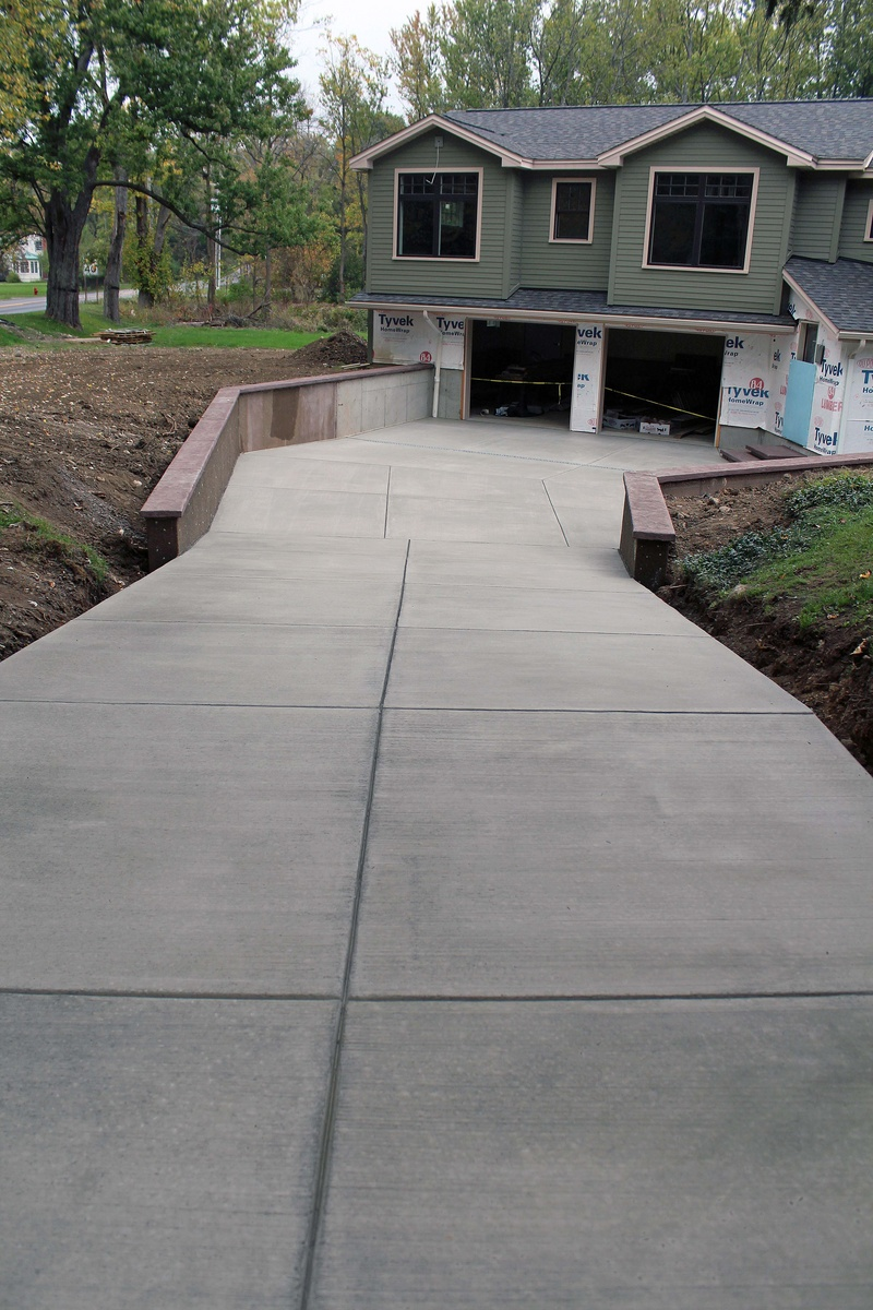 Stamped concrete driveways patios foundations for Pouring concrete driveway
