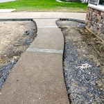 Colored exposed walk with stamped colored decorative feature strips